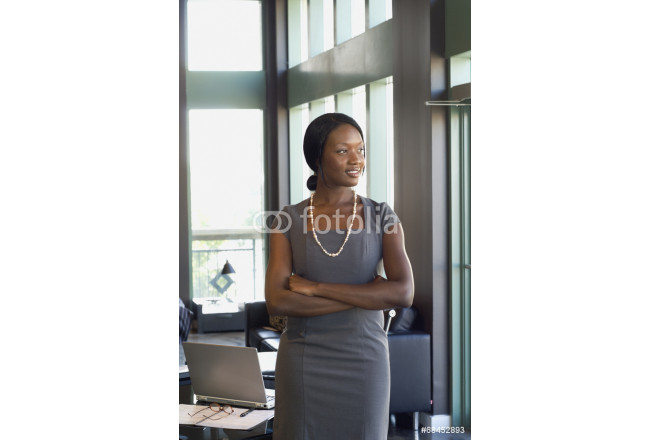 African businesswoman with arms crossed 64239