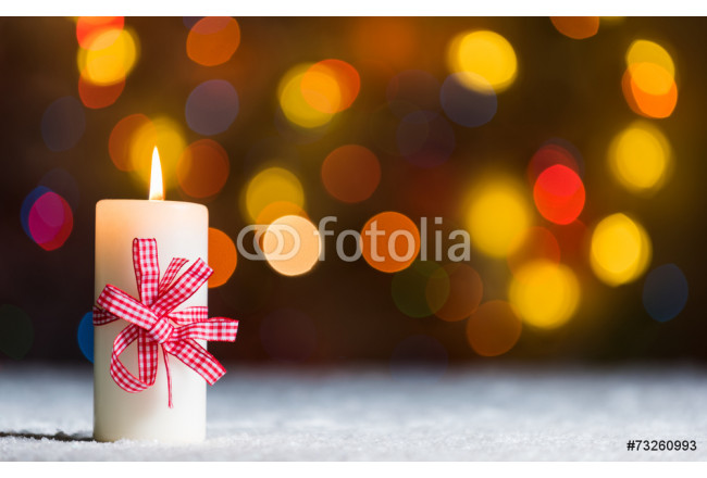 Candle in snow, with bokeh background with copy space 64239