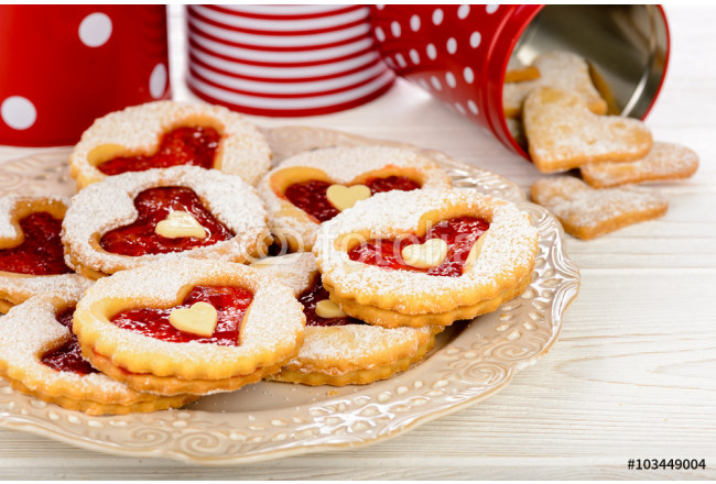 Shortbread cookies in the shape of heart with strawberry jam on wooden table. 64239