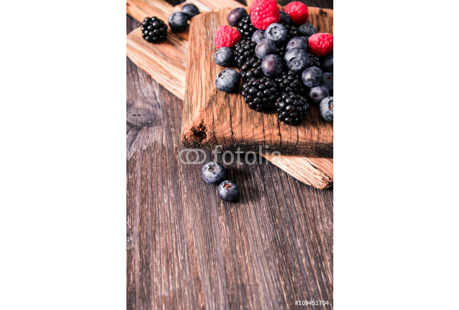 blueberries and raspberries on a wooden background 64239