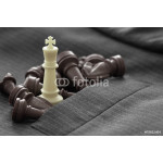 close up of chess figure on suit background strategy or leadersh 64239