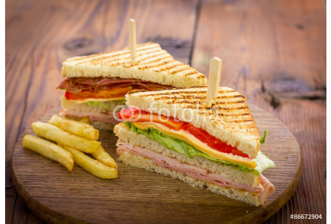 Club sandwiches on the wooden table 64239