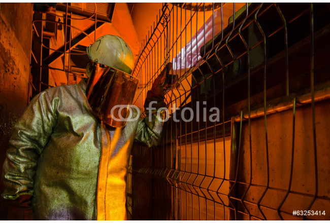 mill worker with hot steel 64239