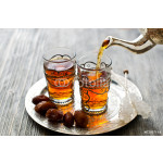 Traditional arabic tea with dates and sugar on a plate 64239