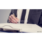 Retro vintage style image of a businessman signing a contract 64239