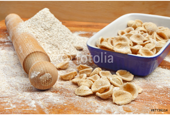 Fresh italian pasta orecchiette in blue porcelain, handmade with whole wheat flour 64239