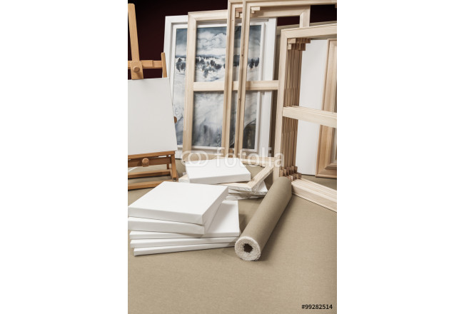 Empty white painter canvases and canvas roll and easel - painter 64239