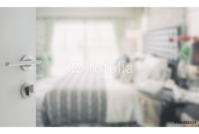 opened white door to blurred background of modern bedroom interior 64239
