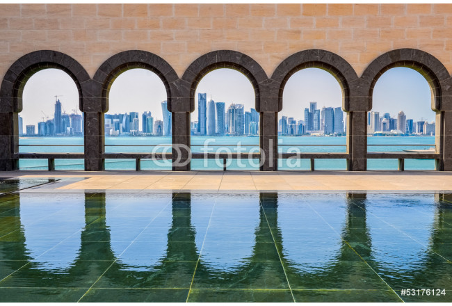 Doha skyline through the arches of the Museum of Islamic art, Do 64239