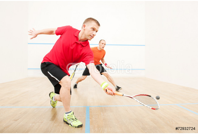 Two men playing match of squash. 64239