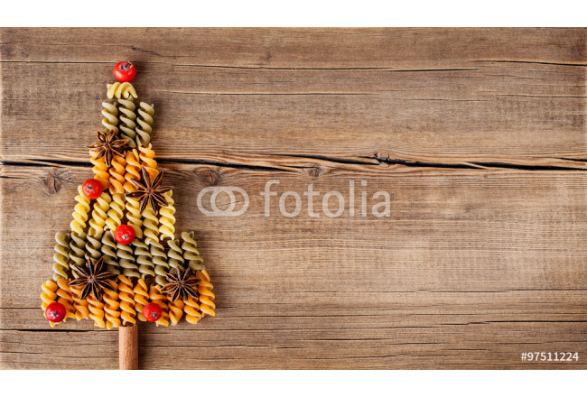 Christmas card with natural decorations on wooden background 64239