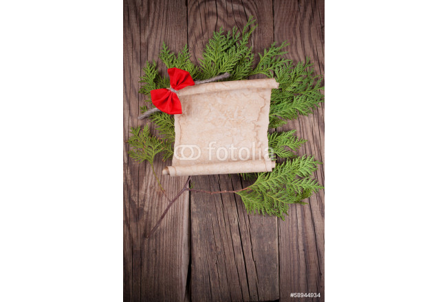 sheet of paper with christmas decoration on wooden background 64239