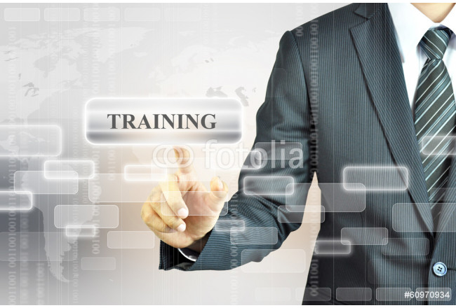 Businessman touching TRAINING button 64239