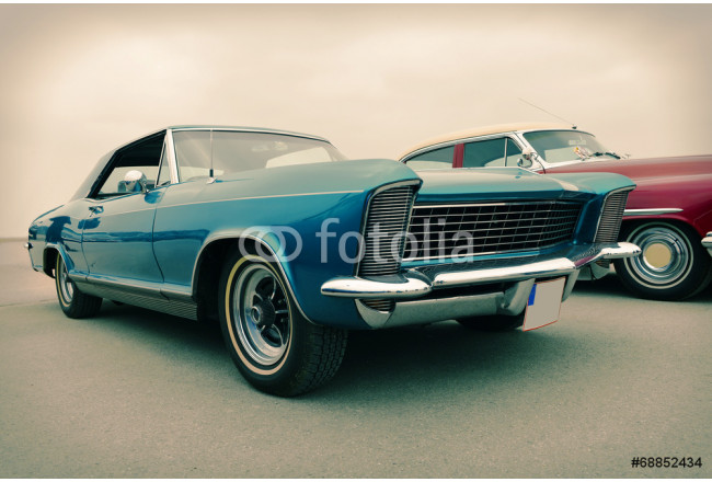 Side view of old luxury car in blue, sixties style, retro 64239