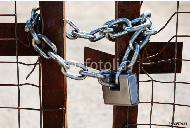 Padlock and chain on a gate 64239