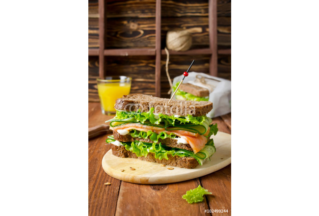Club sandwich with salmon and cucumbers 64239