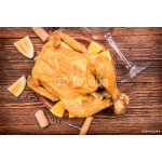 Roasted chicken with lemon and orange. 64239