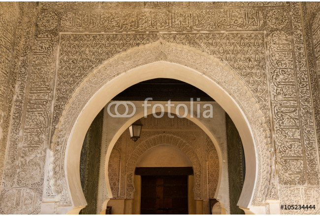 arched entrance to a mosque in the ancient medina of Fes 64239