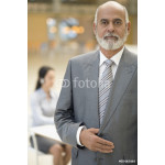 Senior African businessman with hand on jacket 64239