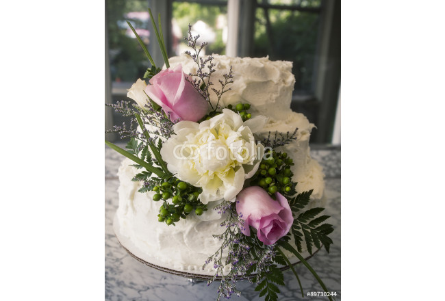 White wedding cake with white icing, roses, peonies, greenery 64239