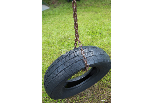 Toile déco Expired tire use for tire swing hanging in a park, Thailand 64239