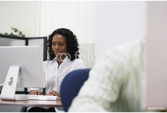African businesswoman working at desk 64239