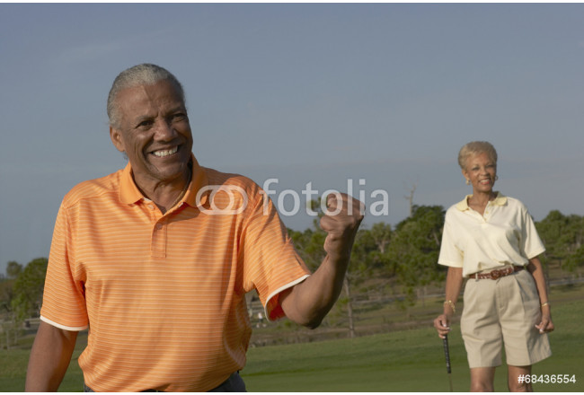 Senior African American couple on golf course 64239