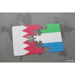 puzzle with the national flag of bahrain and sierra leone on a world map background. 64239