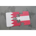 puzzle with the national flag of bahrain and austria on a world map background. 64239