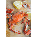 Crabs and lemon on wooden board 64239