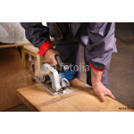 Hands carpenter working with circular saw 64239