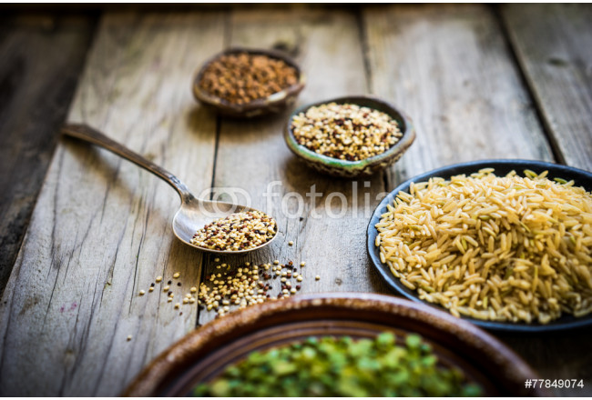 Peas,brown rice,quinoa and buckwheat on wooden background 64239