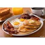 Breakfast with bacon, eggs, pancakes, and toast 64239