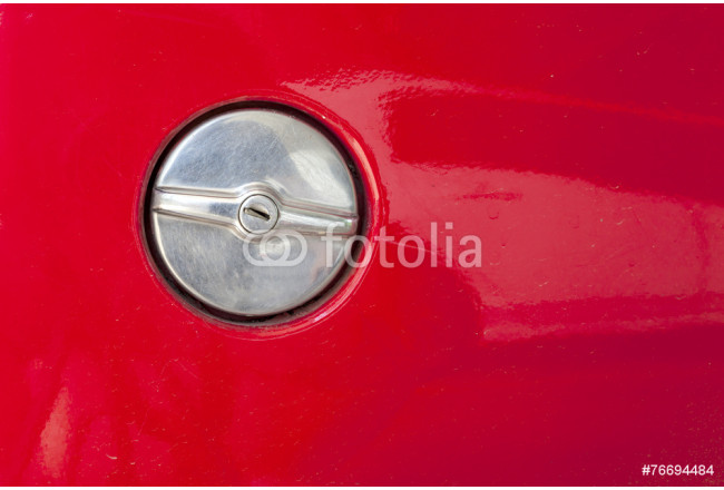 metal fuel tank cap of old red car with the keyhole inside 64239
