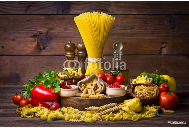 Variety of uncooked pasta and vegetables 64239