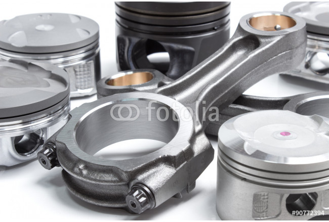 a set of pistons and rods for automobile engine on a white background 64239