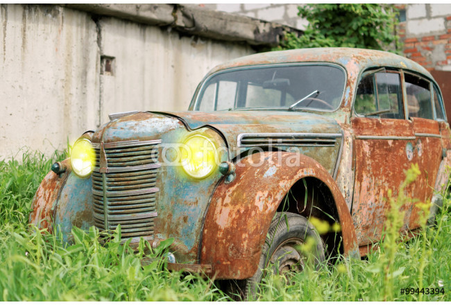An old rusty car 64239