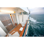balcony with chairs table lamp on ship with view on sea 64239