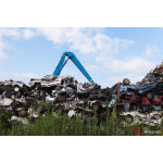 Scrap yard with crushed cars and blue sky 64239