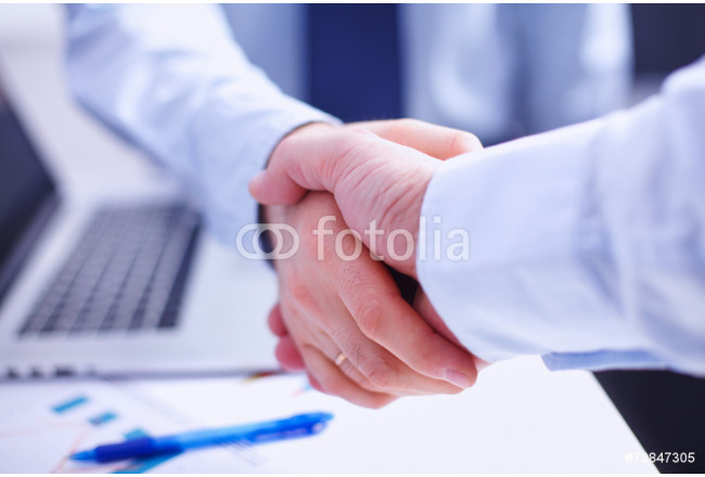 Business people shaking hands, finishing up a meeting 64239