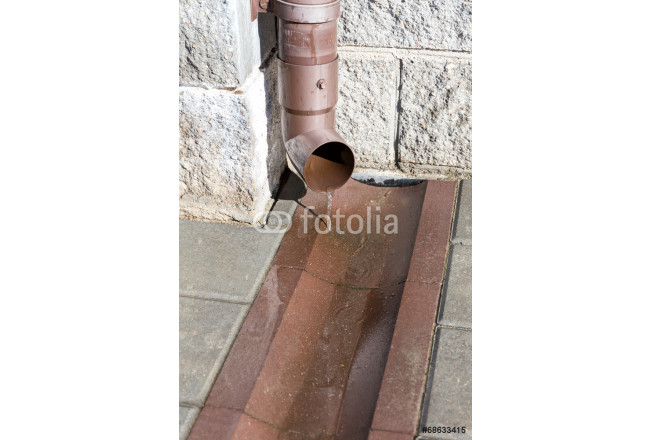 Drain pipe with flowing rain water 64239