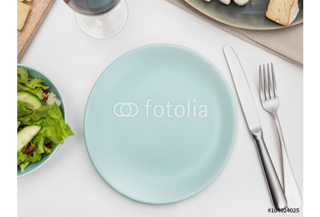 Empty plate on a dining table 64239
