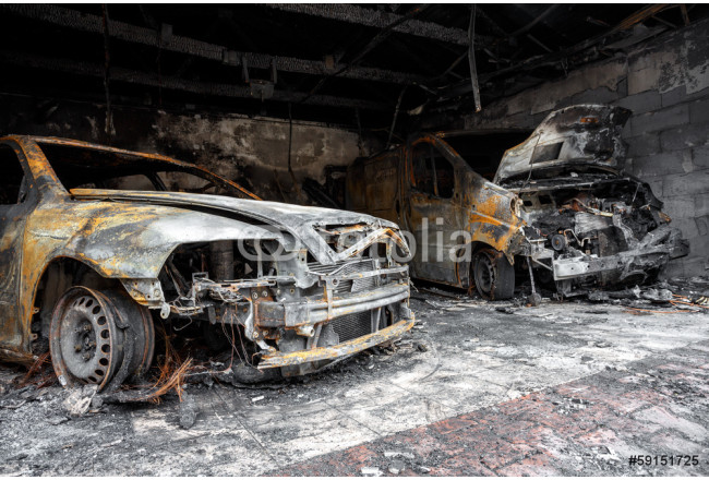 Close up photo of a burned out cars 64239