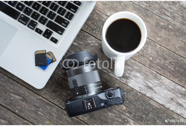 Laptop with digital camera and a coffee cup. 64239