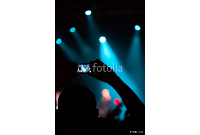 People at concert shooting video or photo. 64239