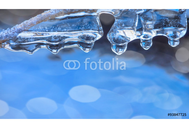Winter background with transparent icicles on water 64239