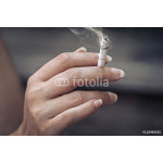 woman holding burning cigarette in hand. smoking woman 64239