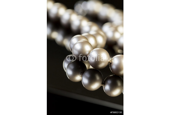 Close up Elegant Pearl Necklace on Glossy Table 64239