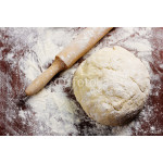 homemade pizza dough with rolling pin on the wooden table 64239
