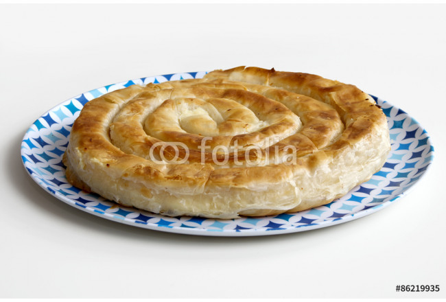 Cheese pie. Homemade balkan burek in a plate. Image isolated on white. 64239